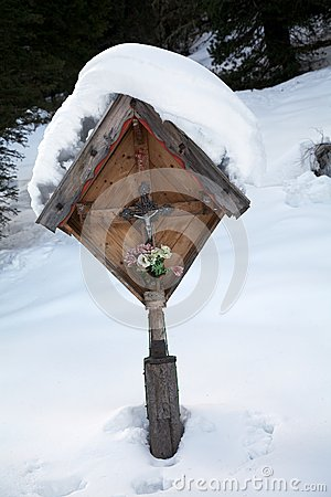 Christian cross among the snow