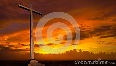 Christian cross on sunset sky. Religion concept.