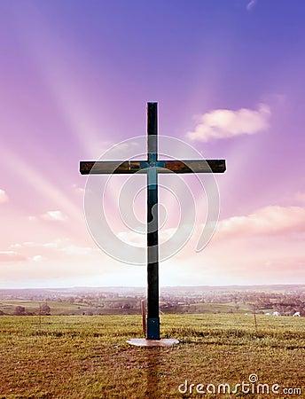 Christian cross at sunset or sunrise