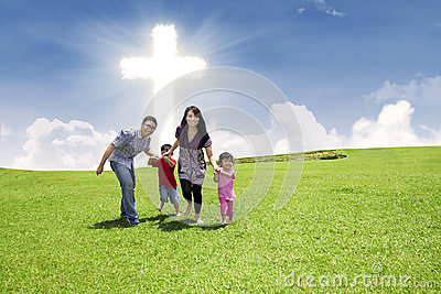 Christian family running in park