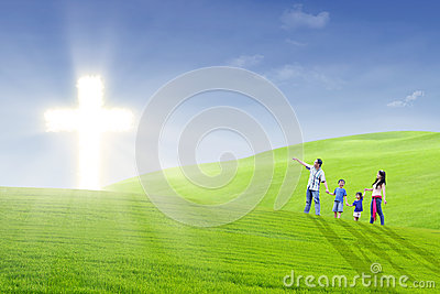 Christian family walk toward the light