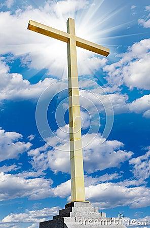 Christian gold cross on sky. Religion and faith concept.