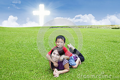 Christian parent and son play on the field
