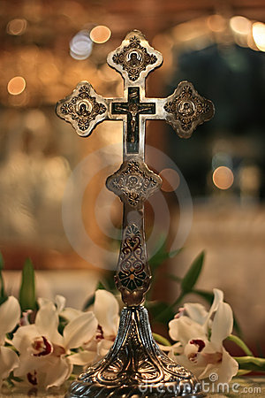Christian silver cross in church