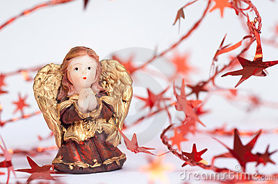 Christmas angel framed with decorative stars