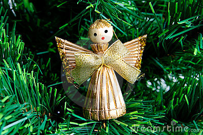 Christmas angel made from straw on christmas tree