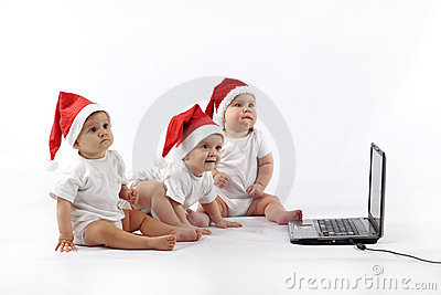 Christmas babies with laptop