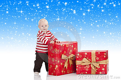 Christmas baby boy with gift box,