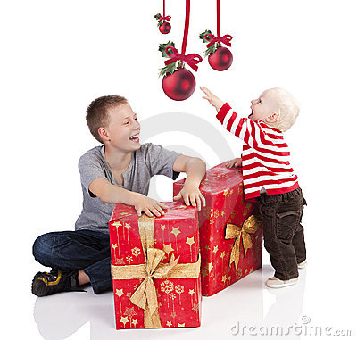 Christmas baby boy with gift box with brother