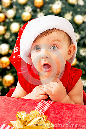 Free Christmas Baby Girl And Present Stock Photo - 83124860