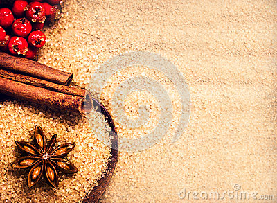 Christmas background with Brown sugar, anise star and cinnamon s