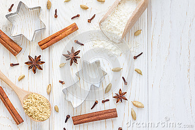 Christmas background with different spices, flour and cookie cutters on white wooden table, copy space, top view Stock Photo