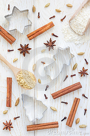 Christmas background with different spices, flour and cookie cutters on white wooden table, vertical Stock Photo