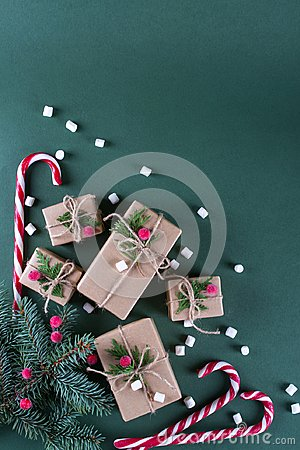 Free Christmas Background. Packing  Gifts In Vintage Beige Craft Paper And Natural Decor. Branches Of Fir And Red Berry . Stock Photography - 105364012
