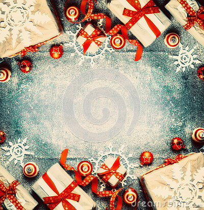 Free Christmas Background With Gift Boxes, Red Festive Holiday Decorations And Paper Snowflakes Stock Photos - 78451413