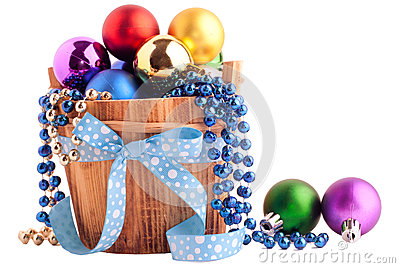 Christmas background with wood bucket and color balls