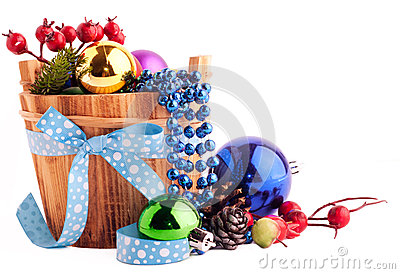 Christmas background with wood bucket, cones, color balls and be