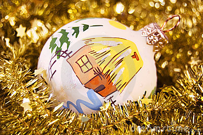 Christmas ball in a golden garland with stars