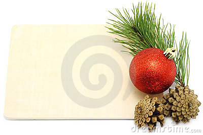 Christmas ball with pinecone and fir tree on a wod