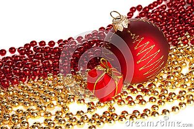 Christmas ball and present box placed on beads