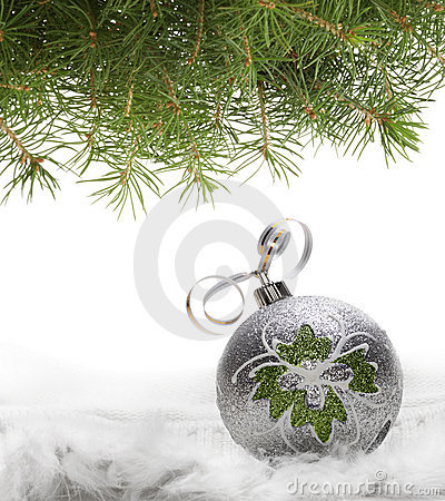 Christmas ball and spruce branch