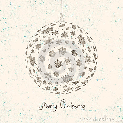 Christmas ball on textured beige background