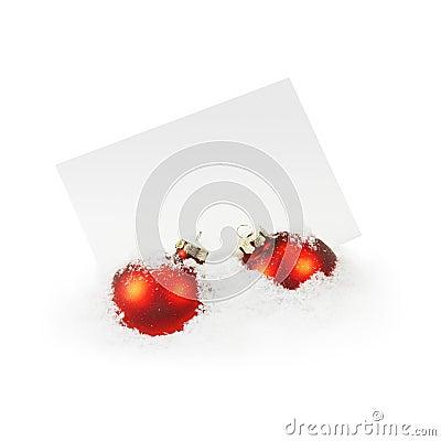Christmas Balls and Greeting Card on White Snow