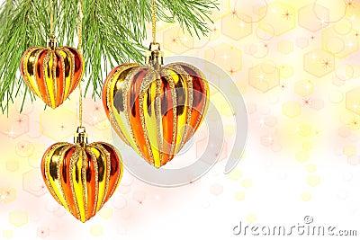 Christmas balls – hearts on pine tree branch