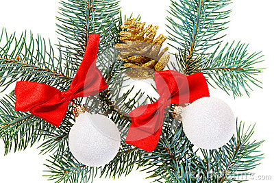 Christmas balls, red bows and cone on fir