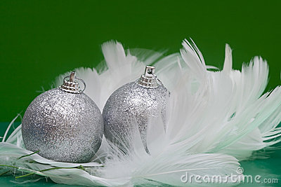 Christmas balls on white feather
