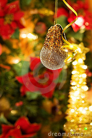 Christmas bauble over golden lights tree