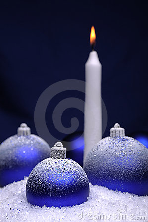 Christmas baubles and candle