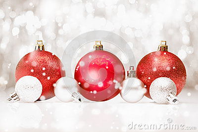 Christmas baubles in falling snow