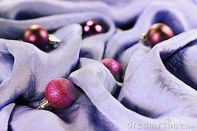 Christmas baubles on a silk background