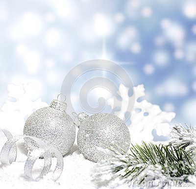 Christmas baubles and silver ribbon on snow