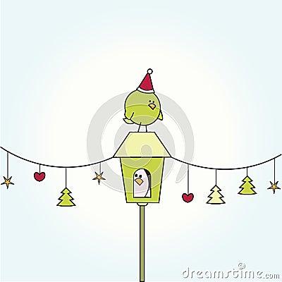 Christmas bird on bird house