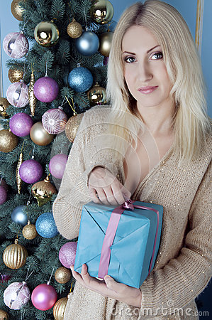 Christmas blonde woman with a present