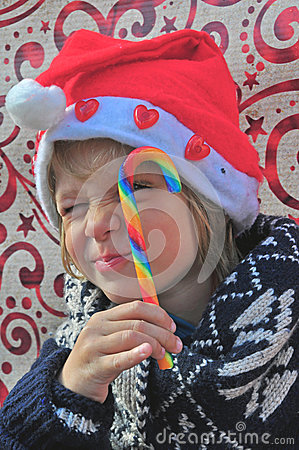 Christmas boy with a candy