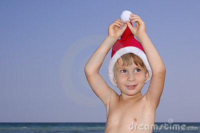 Christmas boy play on the beach