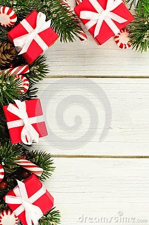 Free Christmas Branches, Gifts And Candy Canes Border On White Wood Royalty Free Stock Image - 61719586
