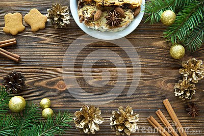 Christmas cake and gingerbread cookies on brown wooden table. Sp Stock Photo