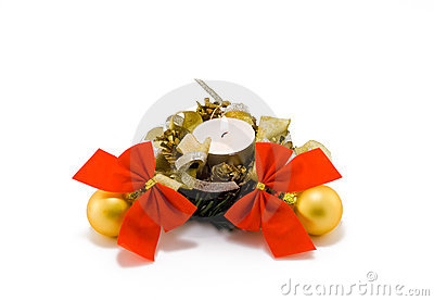 Christmas candle with balls and bows on white