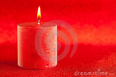 Christmas candle candlelight on red glitter