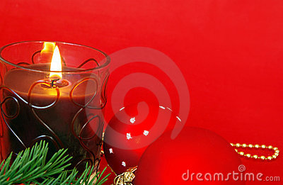 Christmas candle on red