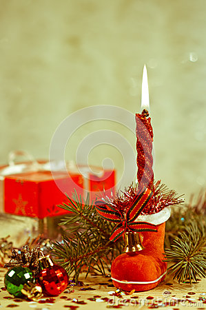 Christmas candle in a red boot