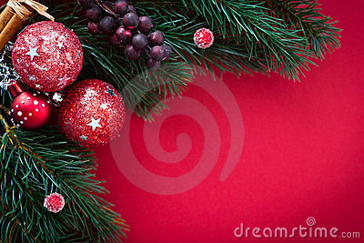 Christmas card with baubles and fir tree on red