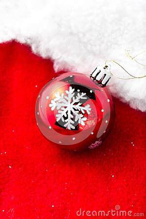 Christmas card with copy space - Christmas bauble on white snow