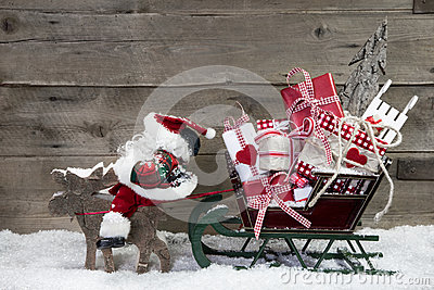 Christmas card decoration: elks pulling santa sleigh of presents