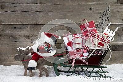 Christmas card decoration: elks pulling santa sleigh of presents