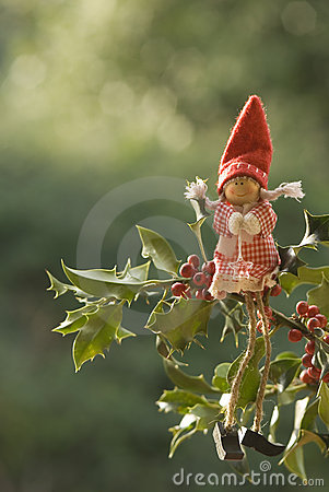 Christmas card, elf sitting on a holly